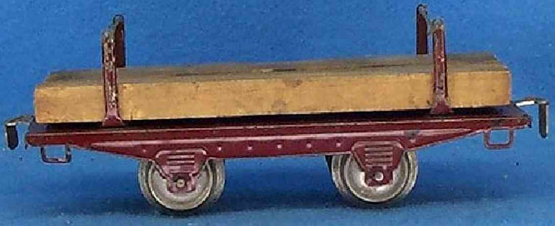 ives 569 (1918) railway toy lumber car; 2-axis, maroon, couplers are riveted on, two set