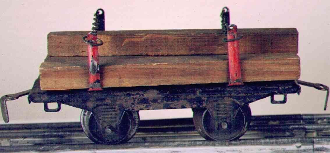ives 57 (1915) railway toy lumber car; 2-axis, black lithographed, 4 maroon stakes, ear