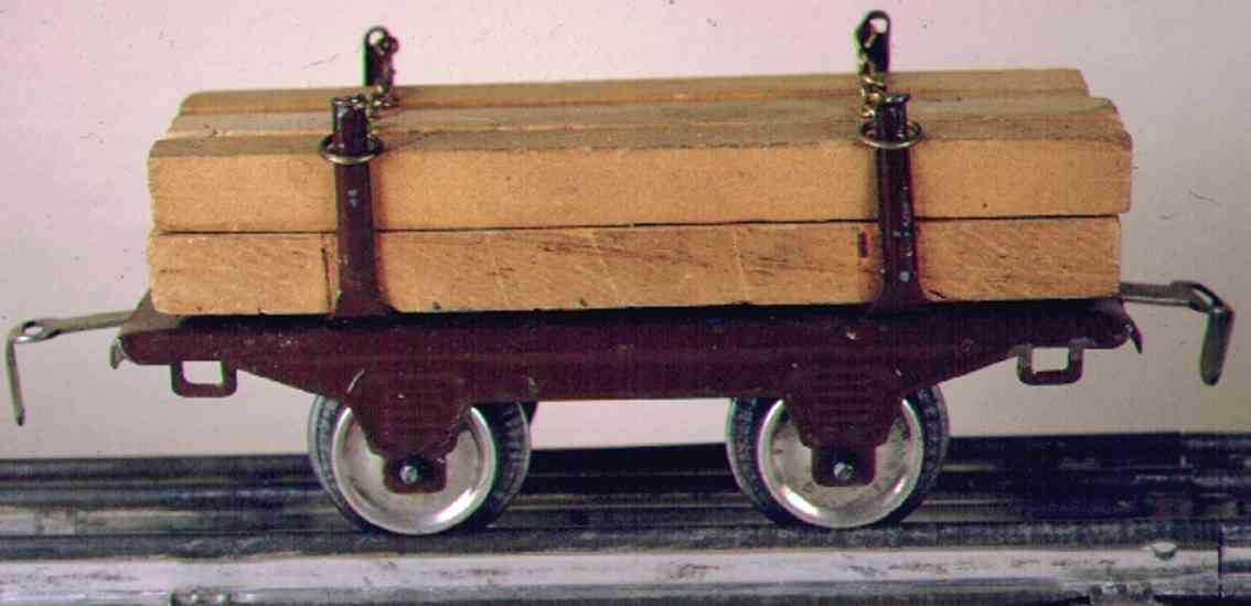 ives 57 (1919) railway toy lumber car; 2-axis, maroon, brown or green lithographed, 4 s