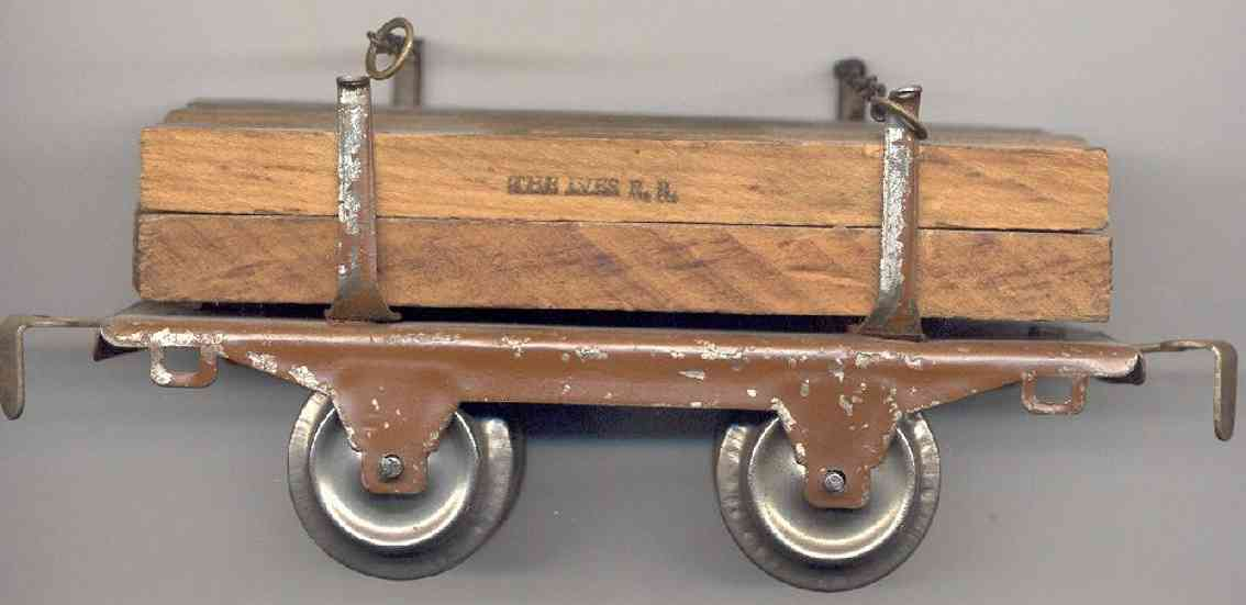 ives 57 (1928) railway toy lumber car; 2-axis,  brown lithographed, 4 stakes of the sam