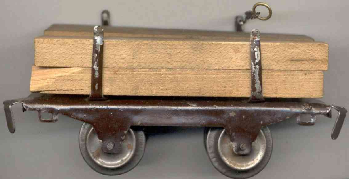 ives 57 (1929) railway toy lumber car; 2-axis, dark brown lithographed, 4 stakes of the