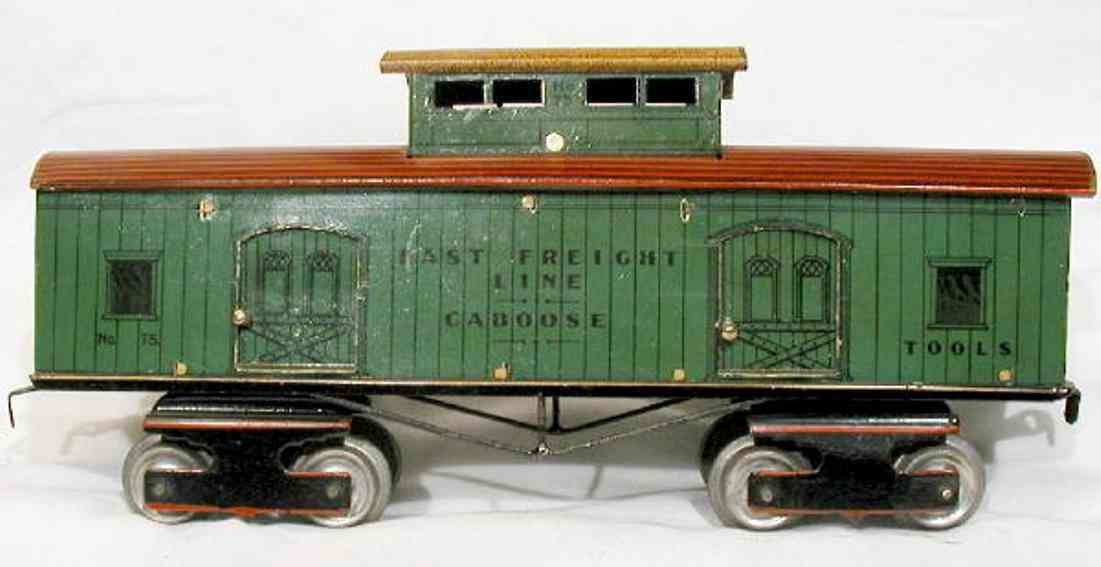 ives 75 railway toy caboose in green, note number lithographed on cupola. letter