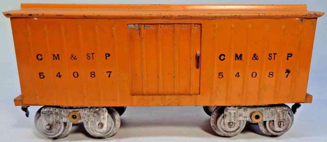 lionel 114 54087 railway toy boxcar painted in yellow-orange standard gauge