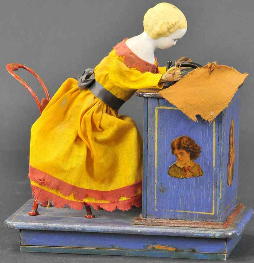 ives wooden toy girl with mechanical sewing machine robert j. clay