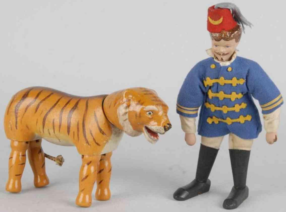 Schoenhut Löwenbändiger mit Tiger mit gemalten Augen