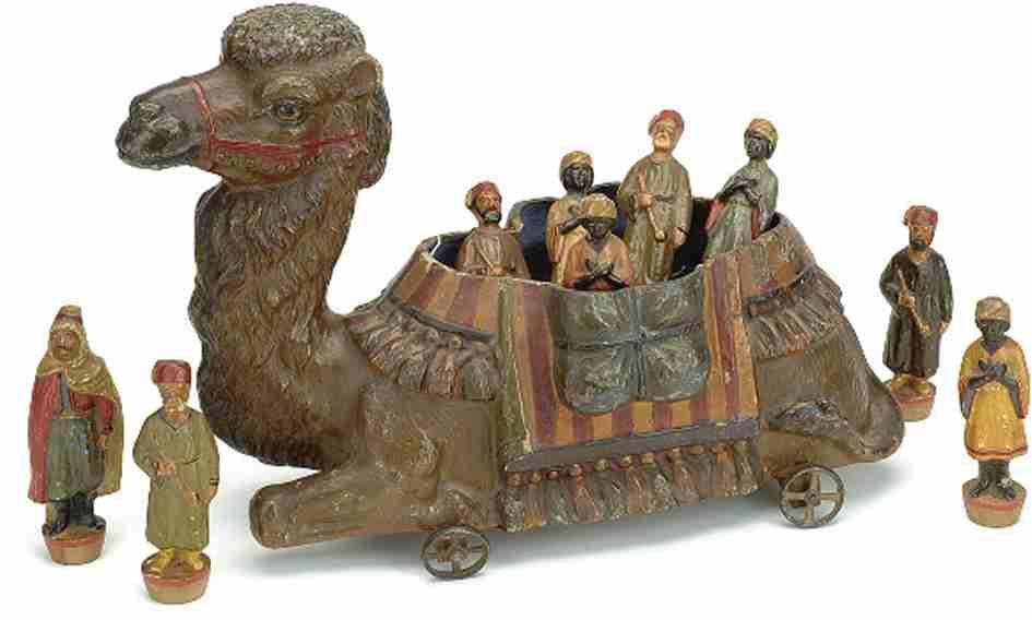 Kamel mit Arabern als Kegel aus Papiermache