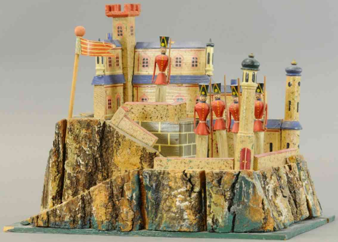 wooden toy castle with soldiers