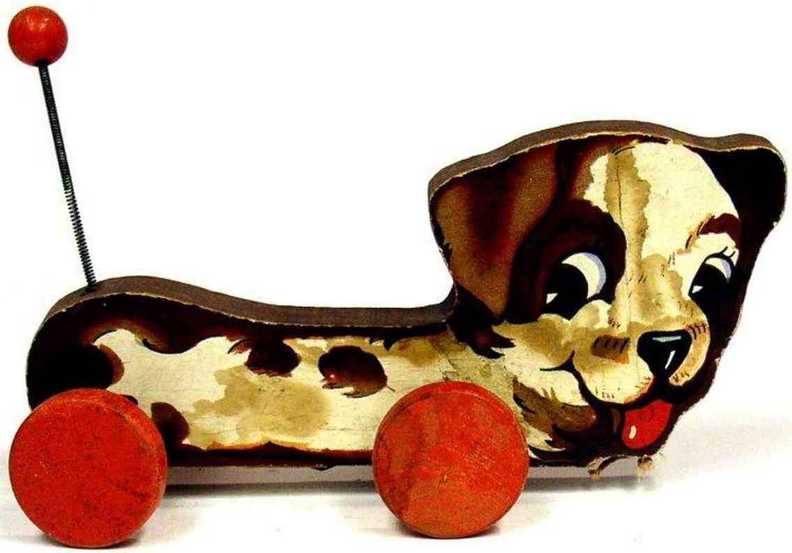 fisher-price 437 wooden toy waggy woofy dog on red wheels
