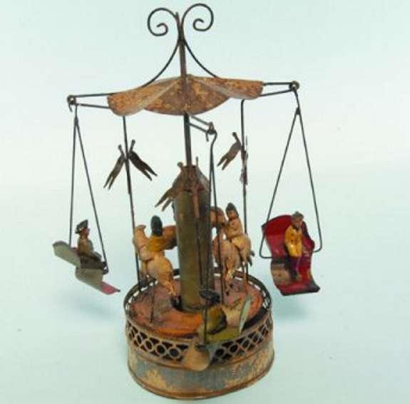 Bing Karussell mit Uhrwerk drei Gondeln mit Figuren und Baldachin