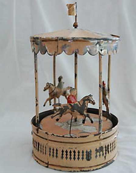 guenthermann  blech spielzeug karussell uhrwerk drei pferder figuren