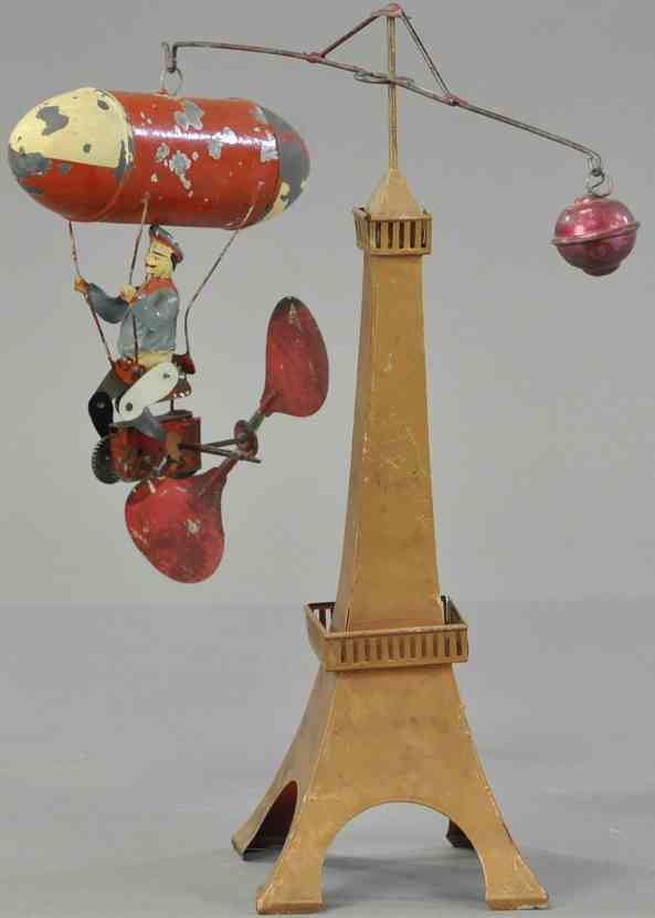 mueller & kadeder blech spielzeug karussell lenkbares zweirad fahrer zeppelin rot