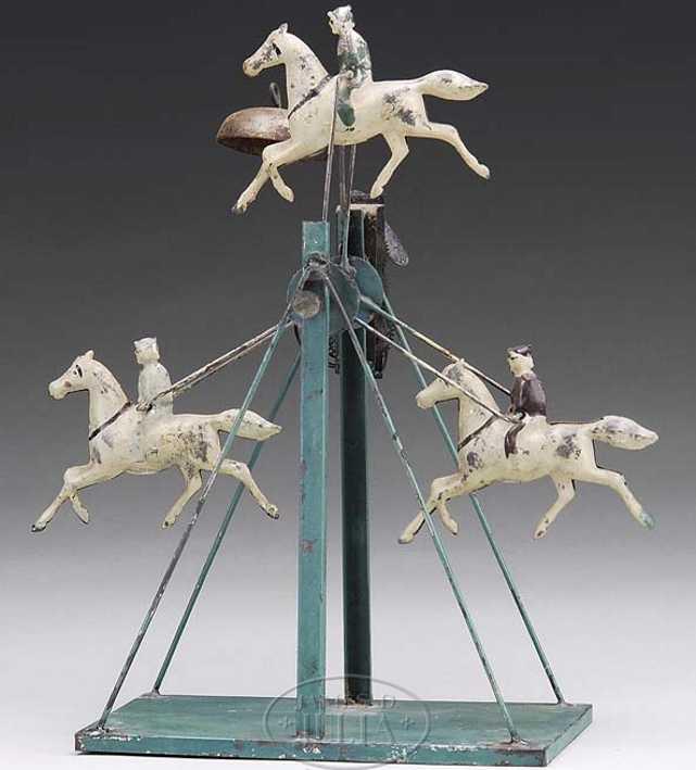 Karussell mit drei Pferden
