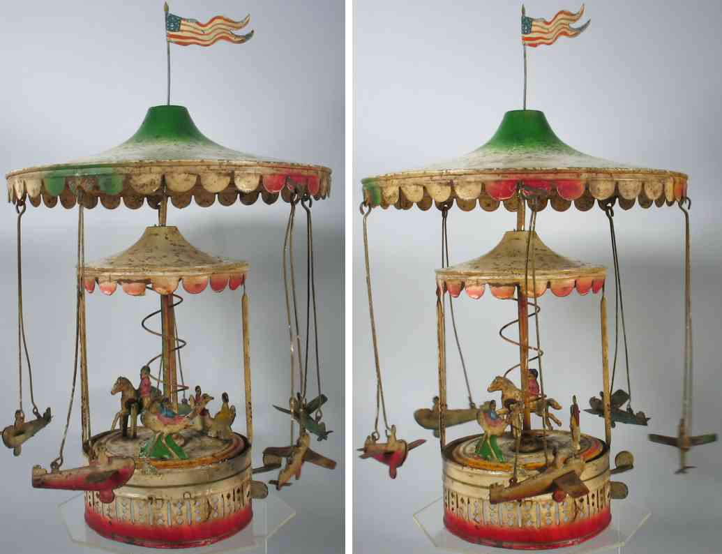 tin toy german tin carousel with double canopy and five planes bing gunthermann