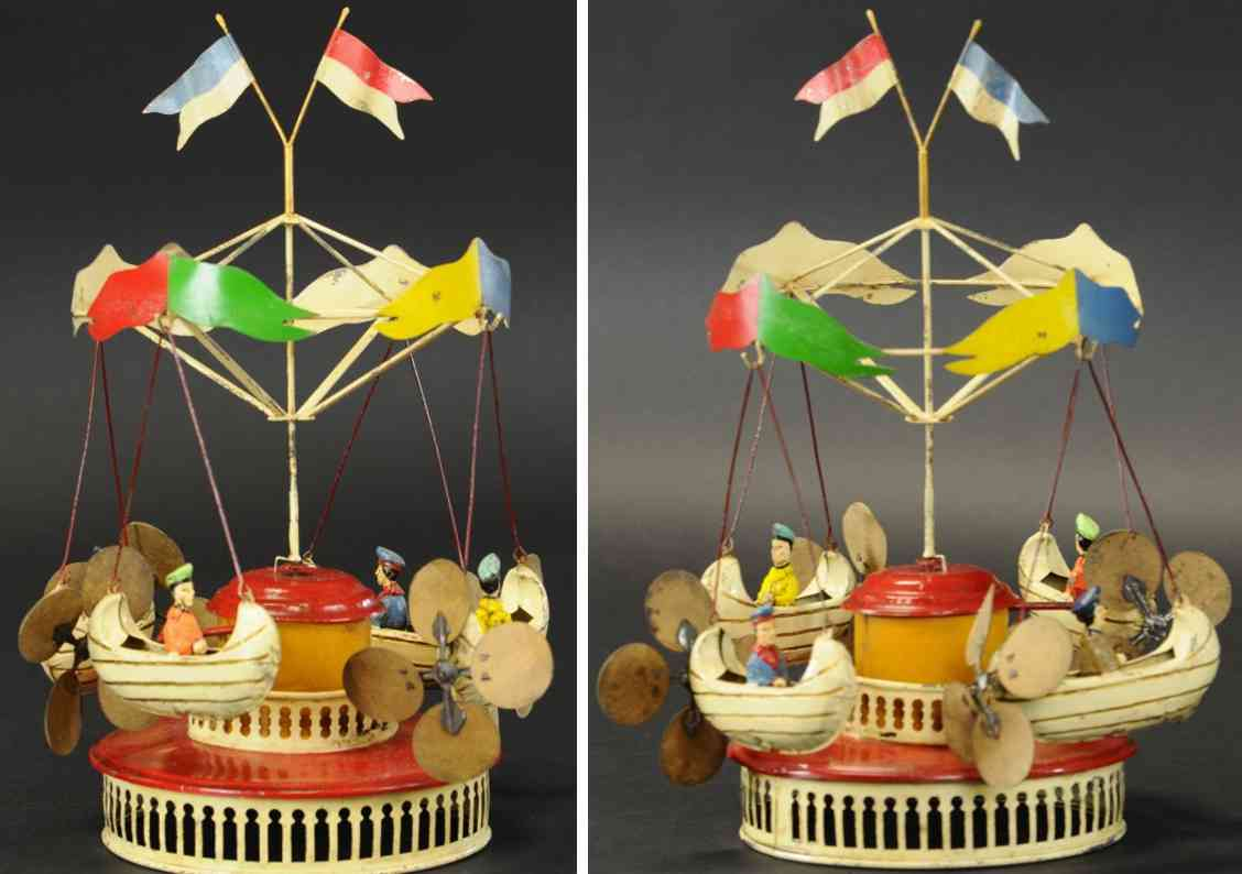 tin toy carousel with flying boats