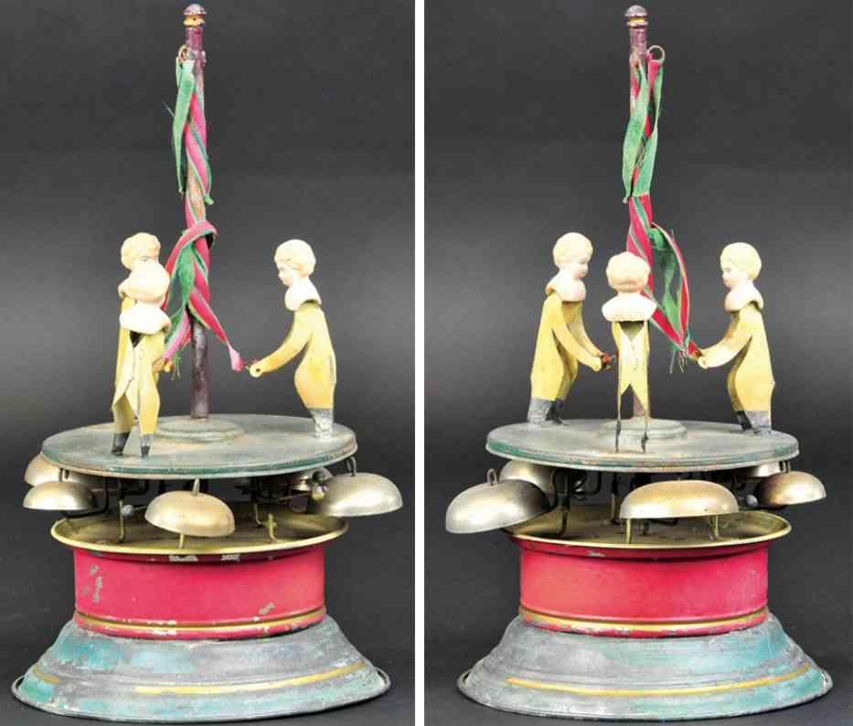 blech spielzeug karussell drei kinder auf plattform mit maibaum