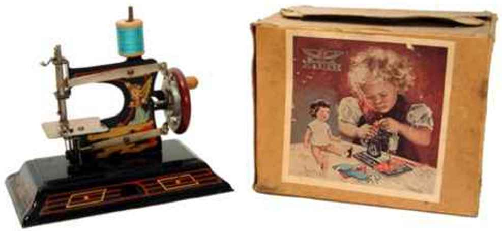 casige 121 kindernaehmaschine nähmaschine, eine nr. 0 auf geschlossenem blechsockel, adler