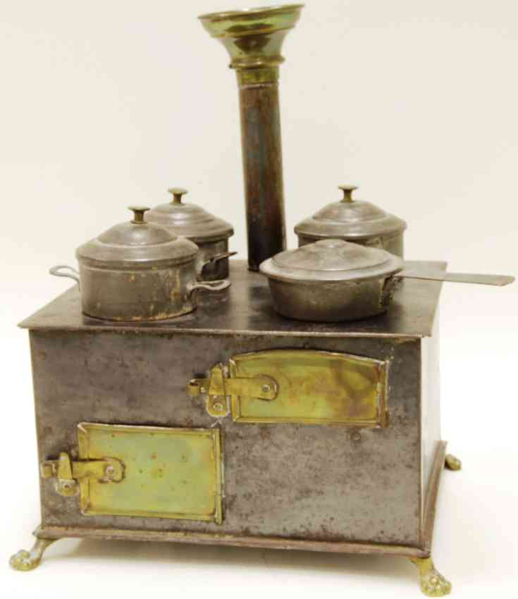 bing tin toy kitchen small stove with lion's feet four cakes