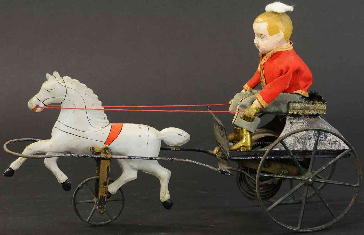 althof bergmann & co tin toy boy in cart and single galloping horse with clockwork