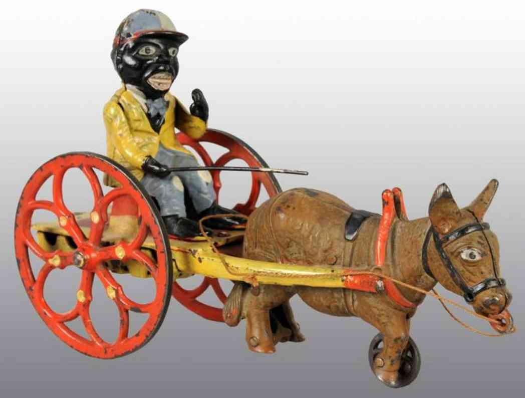 Arcade Stevens Donkey cart with a brown mule and driver