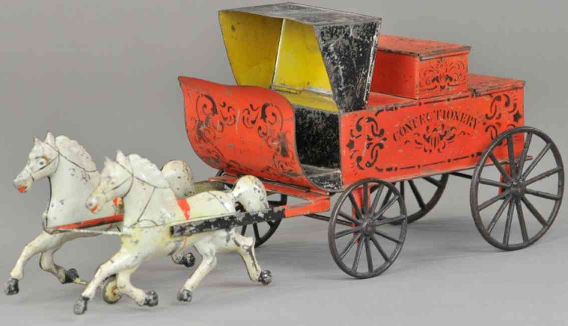 brown georgetin toy confectionary wagon two horses