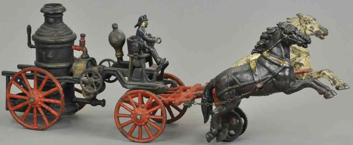 carpenter cast iron toy fire pumper two horses