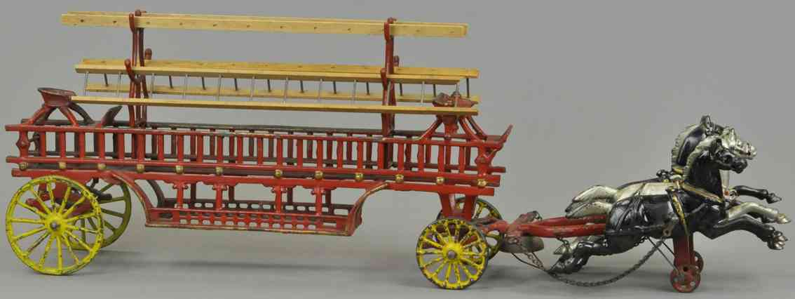 harris toy co cast iron toy horse drawn hook and ladder wagon