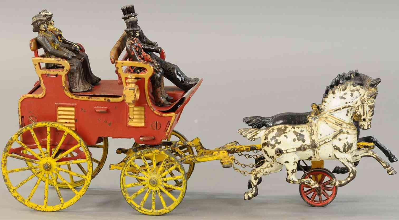 hubley spielzeug gusseisen kutsche zwei sitzreihen zwei pferde vier figuren