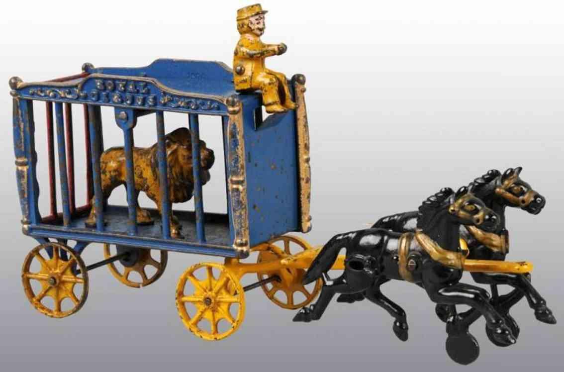 Hubley Zirkuskäfigwagen in blau mit zwei Pfedern Kutscher und Löwe