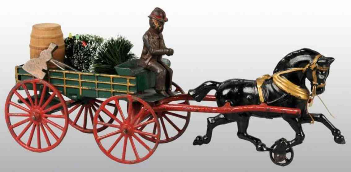 Hubley Express wagon with figure black horse ax barrel and Christmas tree