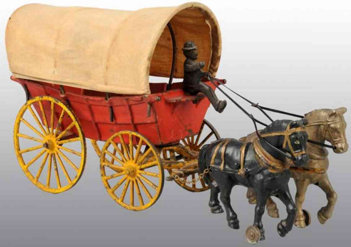 Hubley Horse drawn covered wagon pulled by two horses