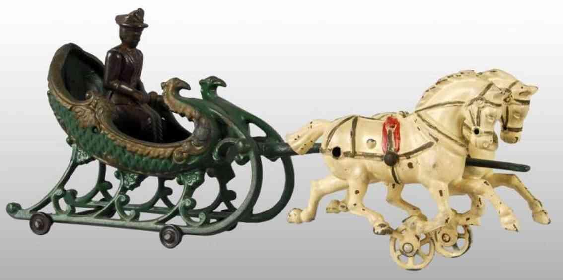 hubley spielzeug gusseisen schlittenkutsche zwei pferde frau