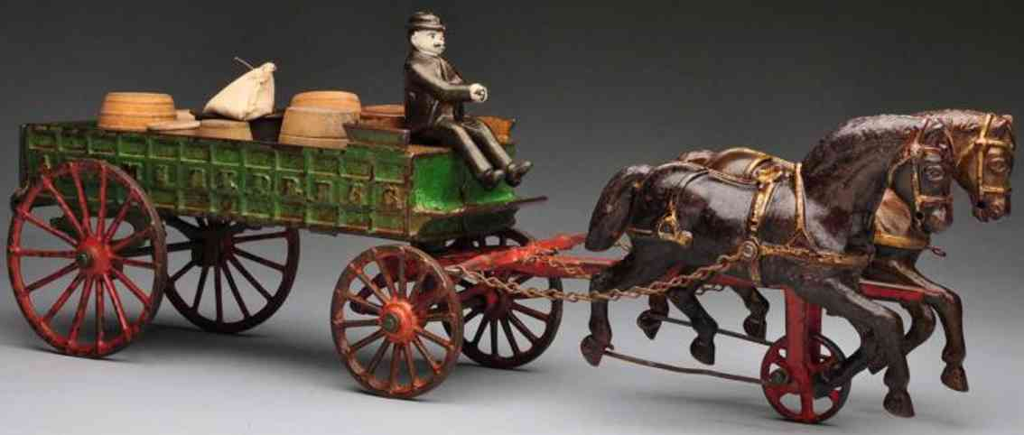 ives cast iron toy adams express wagon two horses