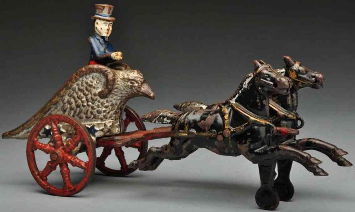 kenton hardware co cast iron toy cast iron uncle sam eagle chariot two black horses