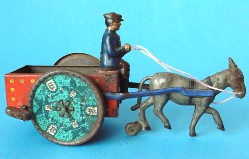 lehmann 680 coach na-ob donkey cart tin windup toy driver