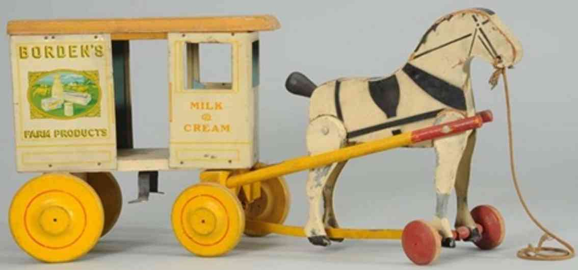 rich toys inc wooden tin toy coach border's horse cart