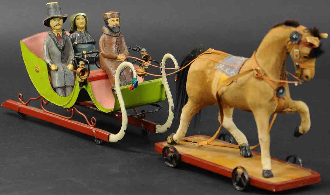 rock & graner tin toy coach snow sleigh with three figures horse realskin leather bridles