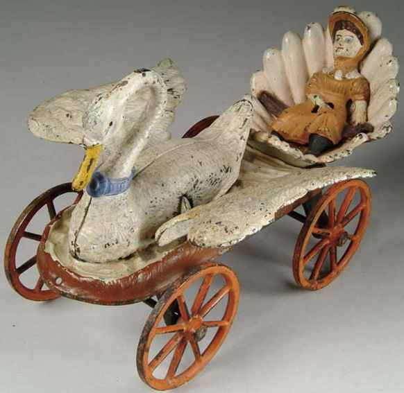 stevens co j & e cast iron toy swan chariot young lady sits in shell seat