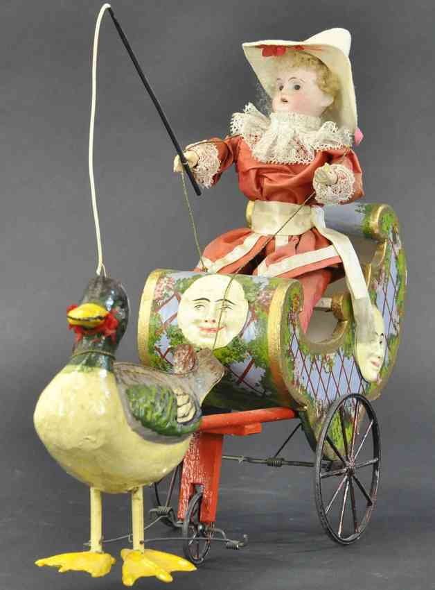 tin toy coach whimsical boy riding duck drawn carriage