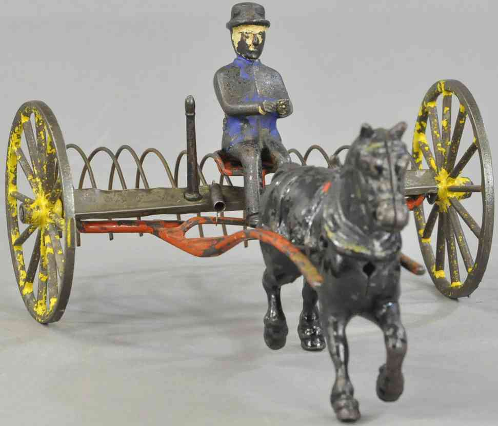 wilkins cast iron toy horse drawn hay rake with figure