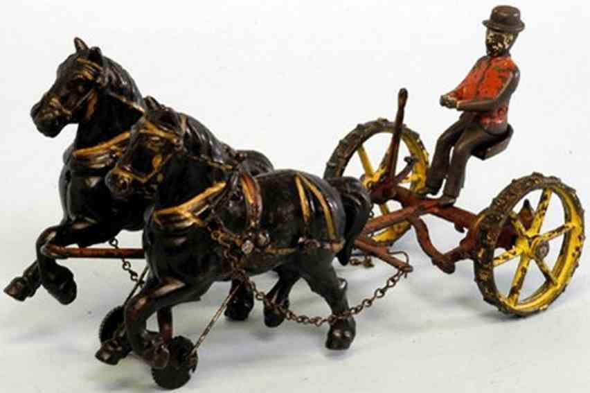 wilkins spielzeug gusseisen kutsche maehwerk zwei pferde kutscher