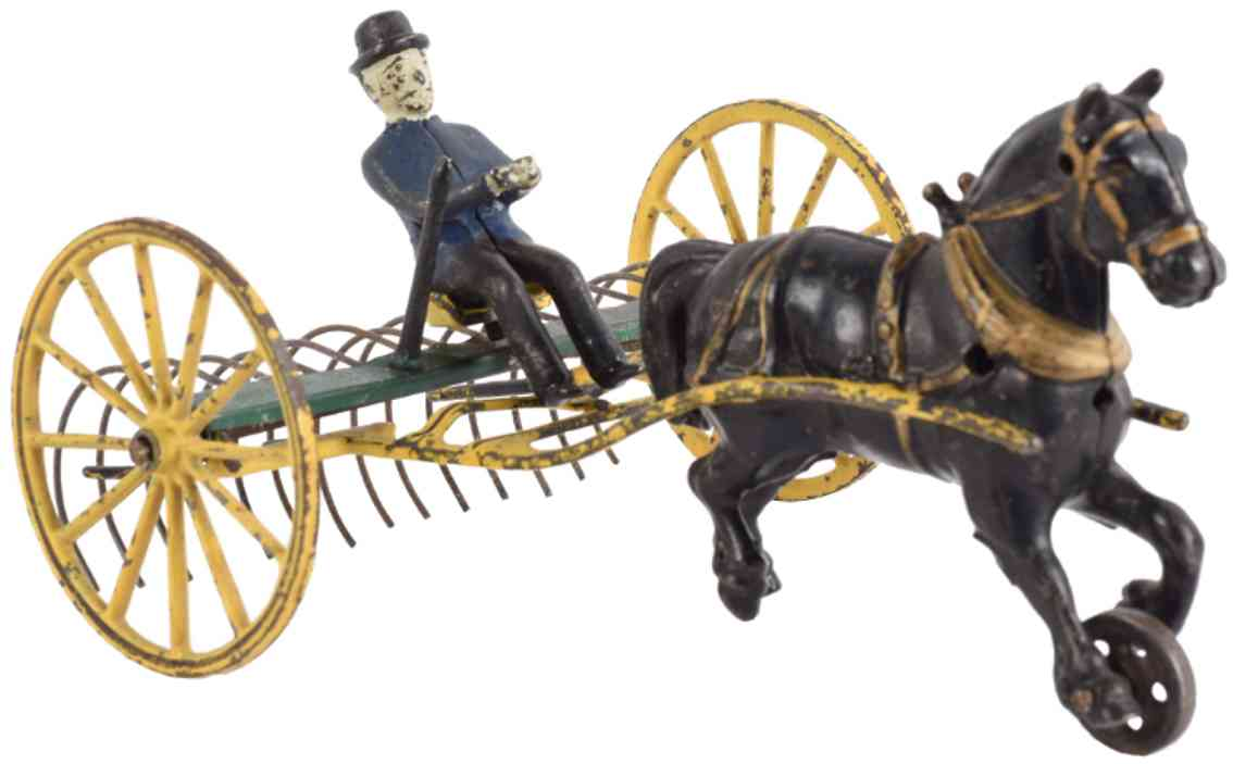 wilkins cast iron toy horse drawn hay rake with figure yellow red