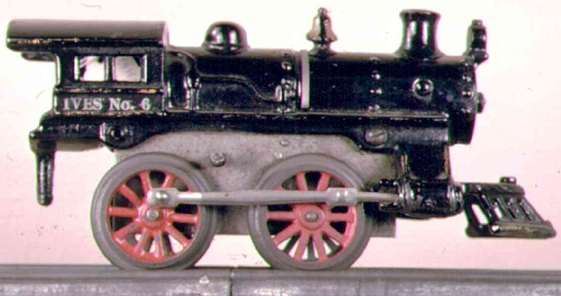 ives 6 (1915) railway toy engine clockwork locomotive of cast iron , in black hand painted wi