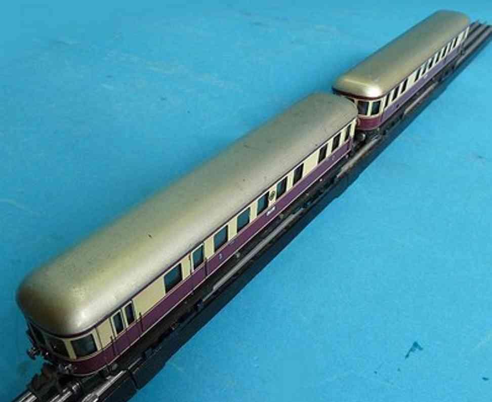 trix 20/58 spielzeug eisenbahn lokomotive dieseltriebwagen; 4-achsig; elfenbein und dunkelrot lithogra