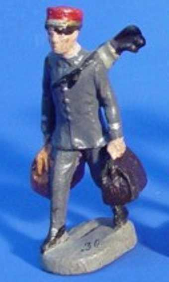 Hausser Elastolin 6607 Boy with gray uniform carries one golf bag