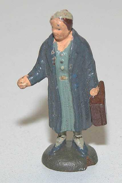 Lineol 187/25 Dame im Mantel mit Koffer