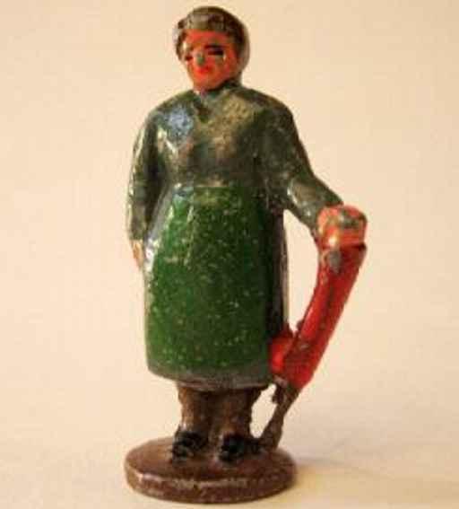 Gussfigur korpulente Dame mit grüner Schürze und Schirm