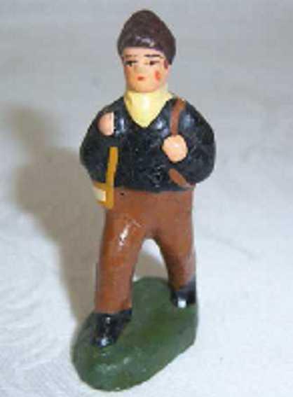 unknown spielzeug eisenbahn figur junge mit schwarzer jacke, brauner hose, schwarzen schuhen a