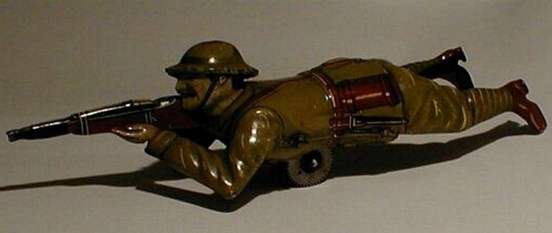 technofix 234E militaer spielzeug figur liegender soldat mit gewehr, lithografiert, soldat in englis