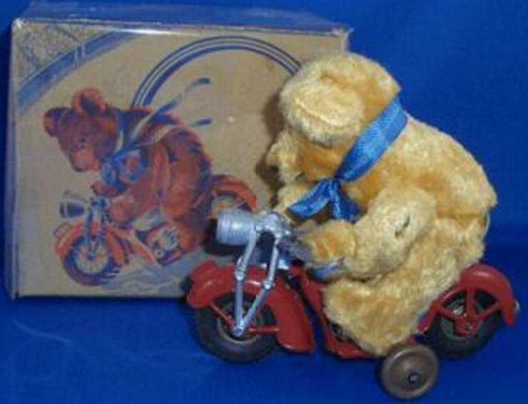 guenthermann tin toy bear on motorcycle clockwork