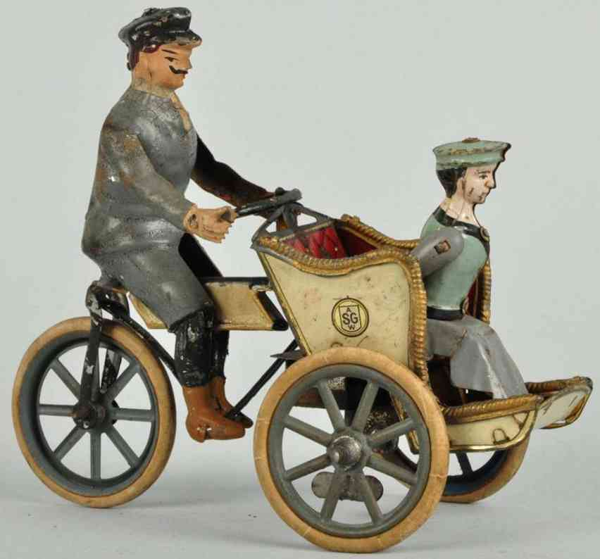 Guenthermann Tin motorcycle with driver and woman